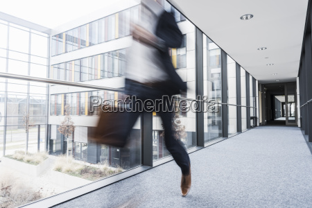 businessman running in corridor of an