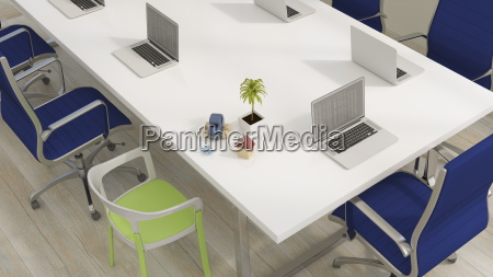 conference table with laptops and familx