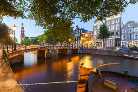 netherlands amsterdam lighted bridge over prinsengracht