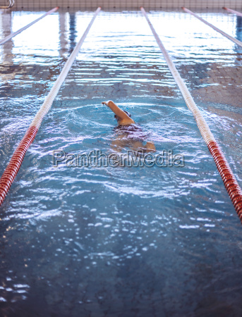 female swimmer in indoor pool