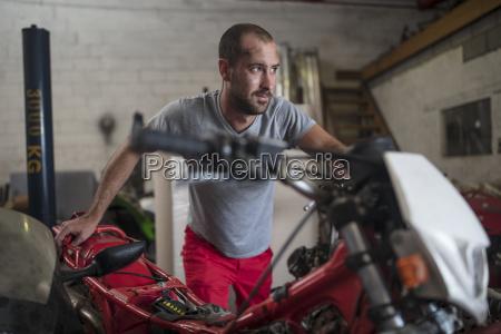 mechanic in motorcycle workshop