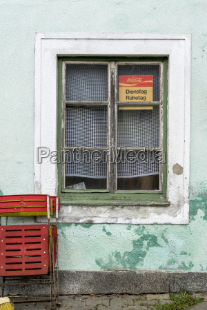 window of guesthouse with sign tuesday