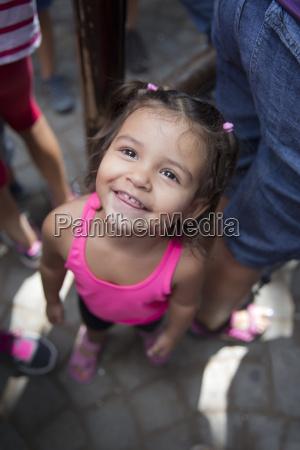 portrait of smiling little girl standing