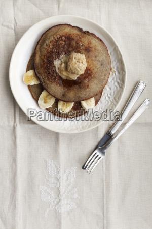 plate of buckwheat pancake with banana