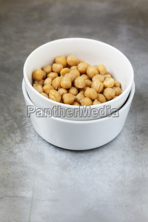 bowl of cooked chickpeas on metal