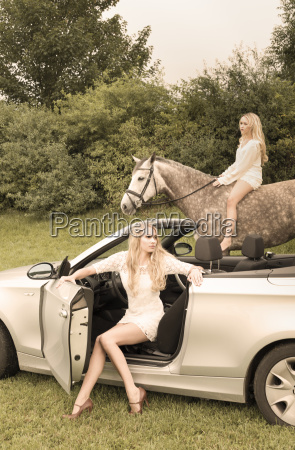 young woman sitting in cabriolet while