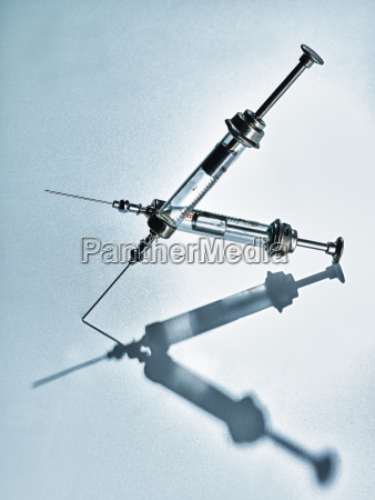 pair of old syringes with medicine