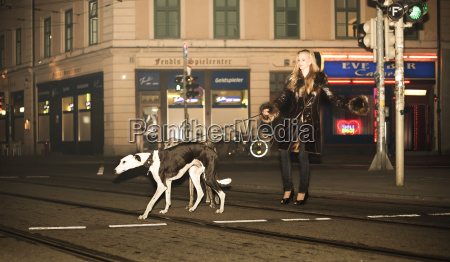 germany munich young woman walking dogs
