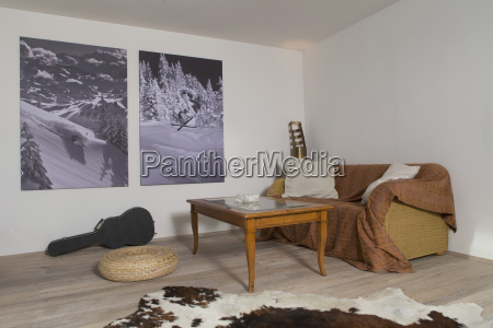 living room with two photographies on