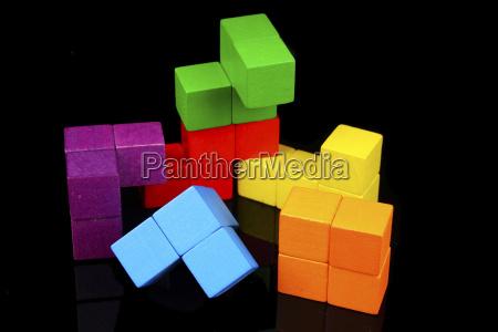 coloured toy blocks on black background