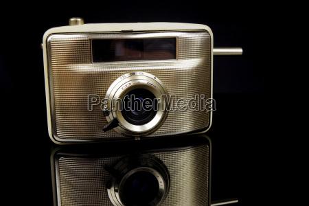 old camera on black background close
