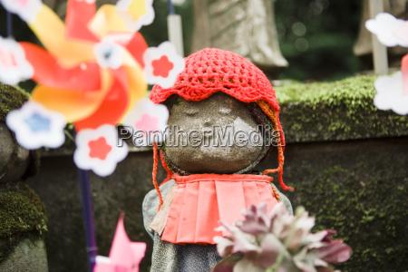 japan tokyo jizo statue decorated with