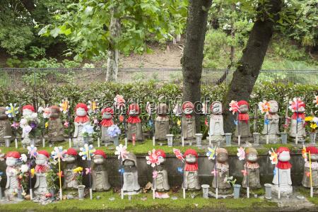 japan tokyo rows of jizo statues