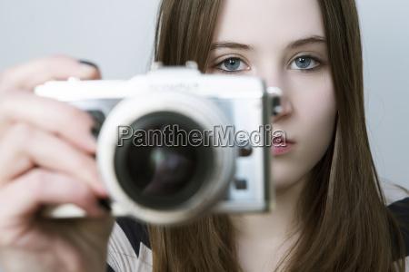 portrait of teenage girl holding digital