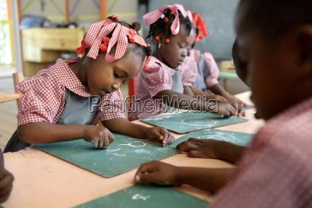 haiti grand boulage schoolgirls in classroom