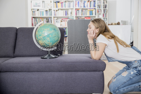 yearning young woman crouching in her