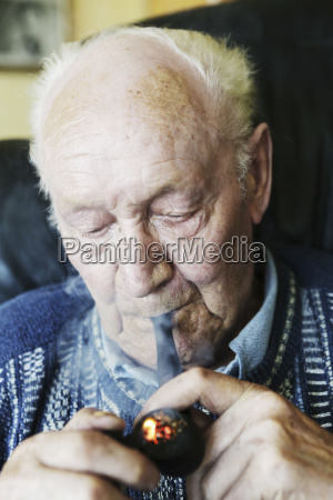 germany senior man holding pipe close