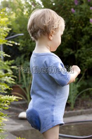 germany girl in garden with wet