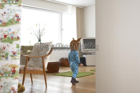 little boy wearing pyjama and bunny