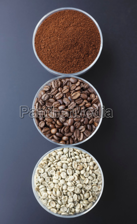 three bowls with ground coffee roasted