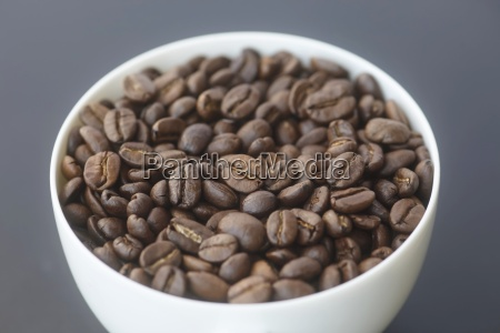 roasted coffee beans in a bowl