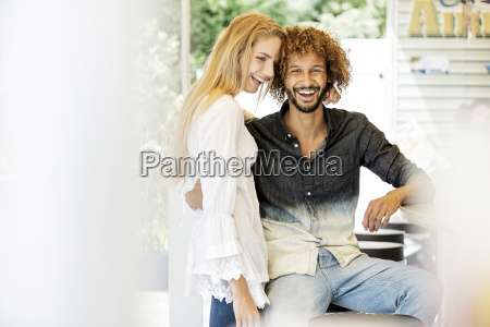 young couple sitting at counter of