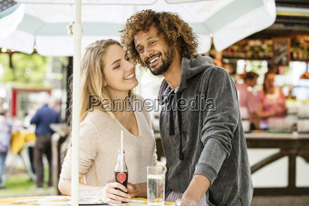 young couple drinking beverage at a