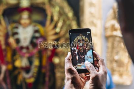singapore sri krishnan temple man taking