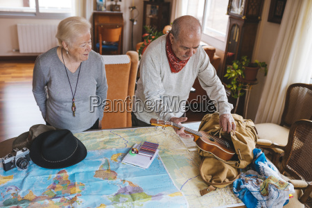 elderly couple planning a trip on