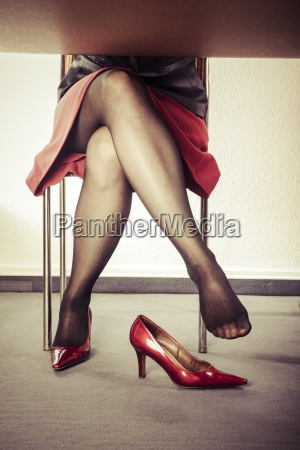 crossed legs of woman with extravagant
