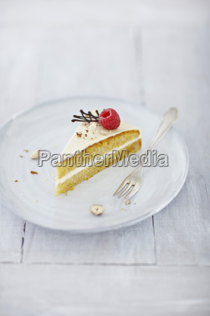 carrot cake with rapsberry on plate