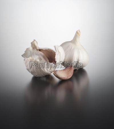 garlic clove and garlic bulb on