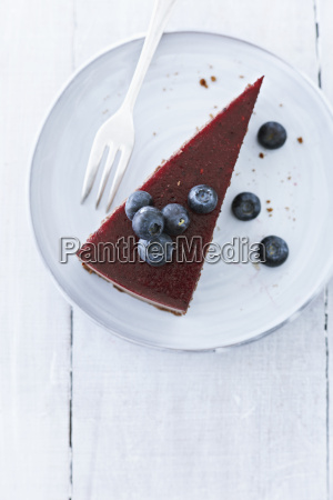 cake with blueberries on plate close