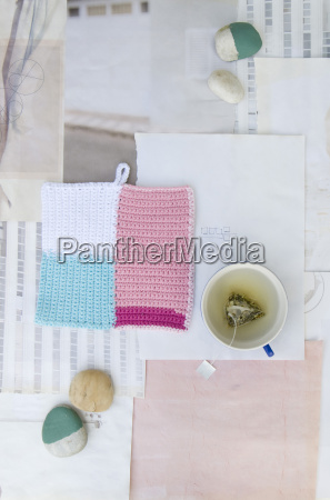 crocheted potholder pebbles and cup of
