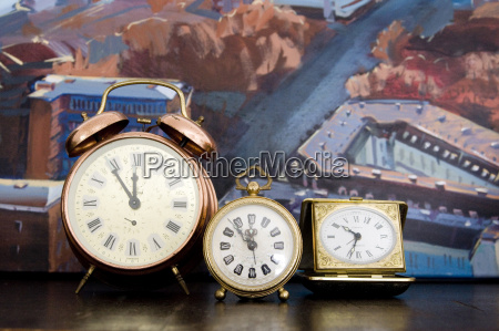 old fashioned alarm clocks in front