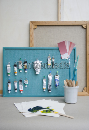 pinboard brushes paint tubes colour chart