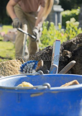 stonemason working on a grave tools