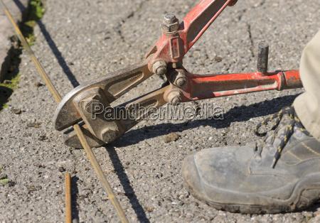 stonemason working on a grave cutting