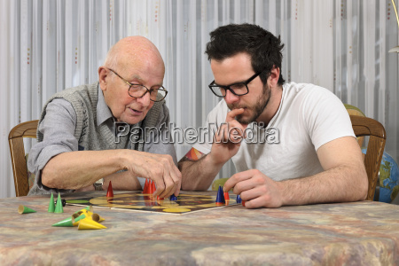 grandfather and grandson playing together trap