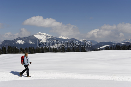 germany mature woman hiking during winter