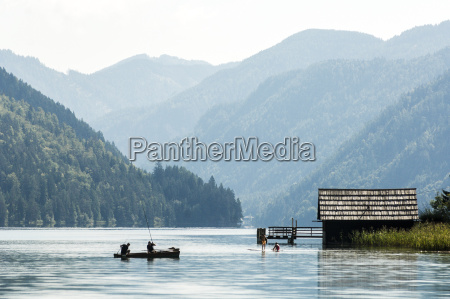 austria carinthia people in boat on