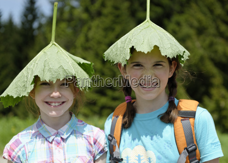 two girls hiking and wearing a
