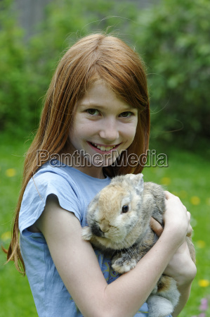 girl holding a dwarf rabbit