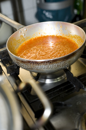 tomato sauce in a pot at