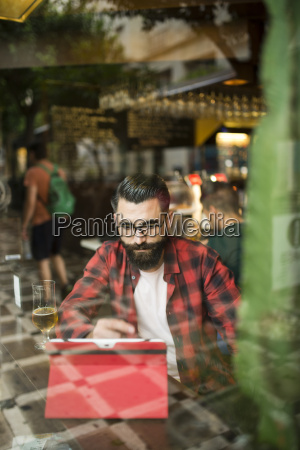 adult bearded hipster style man touching