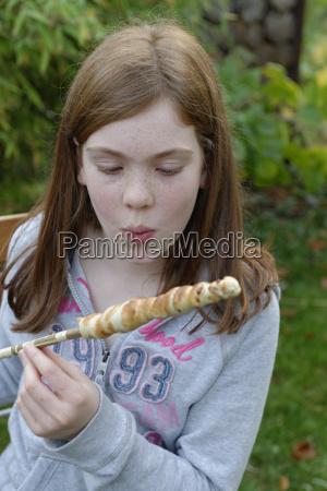 portrait of girl blowing on twist