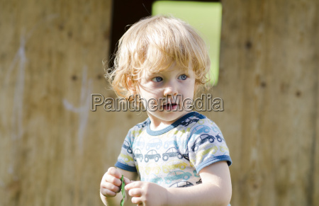 austria boy holding balloon looking away
