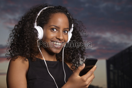 portrait of excited young woman hearing