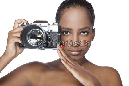 portrait of woman holding camera in