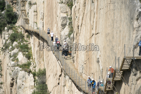 spain ardales tourists walking along the